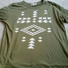 DROP! NEW! Wildfox Green Aztec Arrows Tee Sz L NEW ARRIVAL THIS WEEK! Wildfox army green distressed tee with white aztec / Tribal graphic on front.  Size large. Ridiculously soft material! This has been worn and there is a small stain near the bottom (see pic 1)... I didn't even notice it till right now. Priced higher bc this tee seems to be rare (at least uncommon), and I'm having difficulty finding identical tees for sale (for pricing purposes). But make an offer- I'll probably take it! ;)…