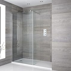 Recessed walk in shower with round chrome shower head and arm, glass screen, and black shower tray Wet Room Bathroom, Bathroom Shop, Big Bathrooms, Bathroom Towels, Small Bathroom, Wet Room Shower Tray, Shower Trays, Concrete Bathroom, Luxury Bathrooms