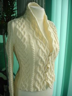 Holy stunning aran work. Button placket needs to be stablized with some grosgrain ribbon on the back.