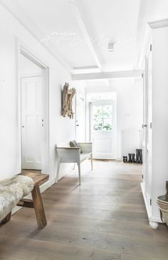 Subtle farm style with lovely wide plank wood floor.