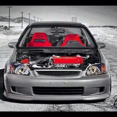Honda Civic.  Helluva show car.  Of course, any money spent on performance is a waste though.