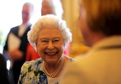 Queen Elizabeth II Photos - Queen Elizabeth II smiles during a reception in Buckingham Palace to mark the Queen's 90th birthday on May 10, 2016 in London, England. - Parliamentary Address at Buckingham Palace