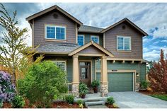 Pillars with stone bases and colors that harmonize with nature distinguish this new home built by D.R. Horton. La Terra at Northshore community. Tacoma, WA.
