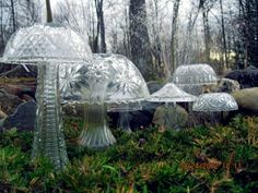 Crystal mushrooms made from bowls and vases. and stick led lights under them at night...