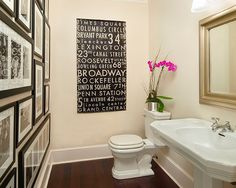 LOVE the wall of photos in all matching black frames with Black and white photos. Imagine with one bright painting randomly in this... like my Blue Dog poster from Jazz Fest '95: Traci Zeller Designs - Fun powder room design with white pedestal sink, silver leaf ...