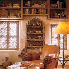 Window coverings made of salt-cedar twigs, called sombraje shutters, shield he study interior from the Sante Fe sun.