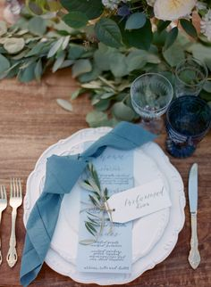 The beautiful shades of blue in this table setting paired with greenery centerpieces give this rustic outdoor wedding a soft romantic touch! The dusty blue napkin light blue menu and cool blue place card go so perfectly together! Table Decoration Wedding, Blue Wedding Decorations, Blue Wedding Centerpieces, Greenery Centerpiece, Wedding Themes, Diy Wedding, Wedding Parties, Wedding Blue, Centerpiece Ideas