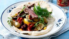 Smoky hot grilled lamb and vegetables in flatbread gets an extra kick from spicy harissa. Don't be alarmed by the long list of ingredients - this dish is very flexible to suit your tastes. Good ready-made harrissa is available in delis and supermarkets.