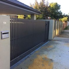 Vertical slats have more privacy than horizontal ones. Definitely a better option Western Automate's Vertical Aluminium Slat Picket Style Sliding Vehicle Gate to match clients existing fence line. Automated with Centsys Evo , Infrared Sensors & Keypad. Fence Gate Design, Steel Gate Design, Front Gate Design, Main Gate Design, House Gate Design, House Front Gate, Front Gates, Garage Gate, Front Fence