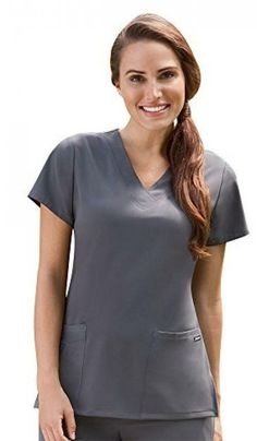 fdbb70d0e65 This sporty V-neck scrub top has an invisible nylon zipper on a convenient  angled cell phone pocket. The fabric is a polyester rayon and spandex blend.