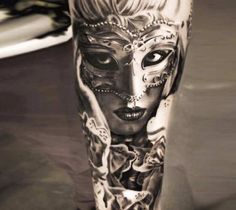 Perfect black and grey realistic tattoo style of Carnival Mask motive done by artist Michael Taguet