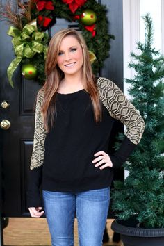 Black sweater with gold lace detail