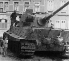 """PzKpfw VI Tiger Ausf B or Königstiger (King Tiger). The heavy tank was abandoned by its crew in early 1945 and is being inspected by a US Army recovery team"""" Tiger Ii, Tiger Tank, Ww2 Tanks, Military Equipment, Panzer, Armored Vehicles, Model Building, Us Army, Historical Photos"""