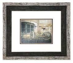Another enchanting street scene has been framed with a variation of mouldings from our new Urban Loft collection. The textures and weathered finish of the moulding are a wonderful combination with the image.   Fotiou Moulding used: 8213GR (Gray) with 8212BR (Autumn Brown). The fillet shown is 4624GO  Click on the link for more information about the Urban Loft collection   #pictureframes #customframing #framing #fotiouframes #rusticframes #distressedlook #walldecor