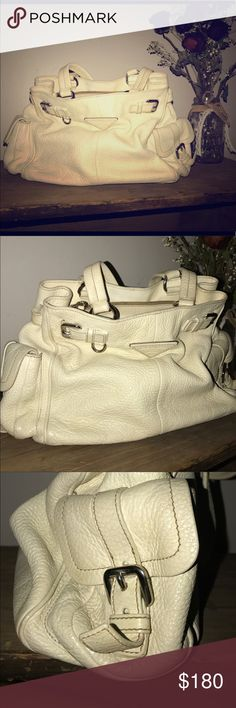 PRADA White Leather Handbag 👜 Gorgeous White Leather Athletic PRADA Handbag. Used but in absolutely great condition. Comes with a Dust-bag. Bought from Poshmark but unfortunately have to sell it... A handbag isn't just a way to transport your essentials. It's a way to compliment and elevate your look!!! Offers are WELCOME!!! Prada Bags Shoulder Bags
