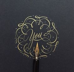 Gorgeous gold ink on black parchment calligraphy.