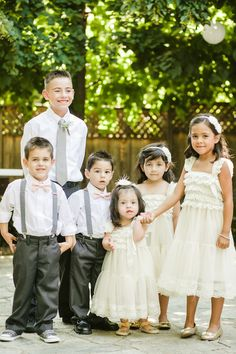 Adorable flower girls and ring bearers in pink and grey
