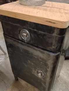 Vintage industrial cabinet with thick wood top, asking $595.