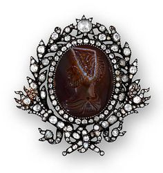 An antique agate and diamond pendant,