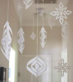 """There's no white Christmas here in Australia (and Christmas is forecast to be a scorcher in Perth this year). Instead, as I showed yesterday, I created a Winter Wonderland inside for my kids. I crocheted a chain stitch """"ladder"""" to hang the snowflakes from Winter Wonderland Decorations, Winter Party Decorations, Winter Wonderland Theme, Winter Wonderland Christmas, Winter Theme, Office Decorations, White Christmas Decorations Diy, Paper Decorations, Holiday Decor"""