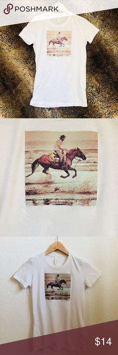Man on horseback women's T-shirt Purchased at Pac sun-women's t shirt with man riding horseback. Size women's small no stains, marks, etc. perfect condition! PacSun Tops Tees - Short Sleeve