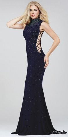 You might get mistaken for a celebrity in the Laced Up Beaded Jersey Prom Dress by Jovani. This sizzling hot dress features a fitted silhouette, lace up side detailing, and crystal bead embellishments for a healthy dose of sparkle. Give the look even more edge with a smokey eye and a jeweled statement bracelet.