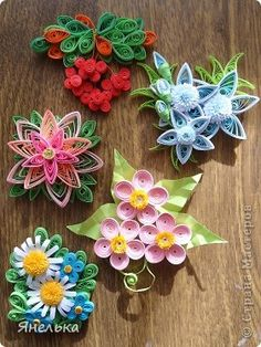 quilled flower brooches ... adorable! ... like the variety of flower techniques  ...