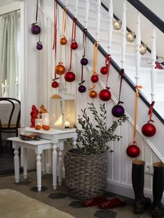 Dress your staircase fir Christmas with large baubles. #christmas #xmasdecor