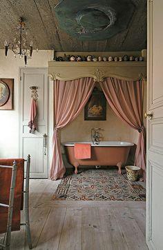 Pink Bathroom by hester. I like the motif but the heads on top shelf kinda creepy.
