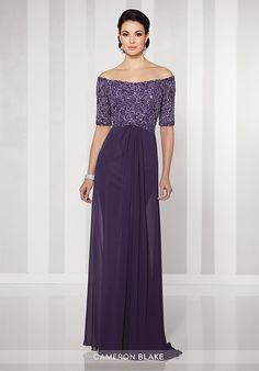 Off-the-shoulder chiffon A-line gown with hand-beaded illusion elbow-length sleeves, bodice encrusted with beading, curved waistline, center front gathered skirt with sweep train.