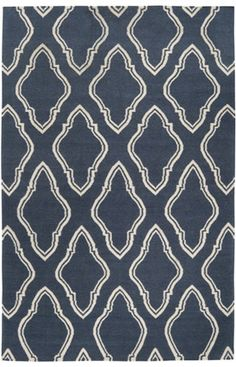 I think in your room a simple trellis, or quatrefoil pattern would look best. Many of these rugs come in other colors as well.