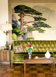 Looove this green velvet sofa. And the mural as it reminds me of my grandma's.