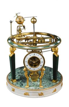 Zacharie Raingo  <br/>Exceptional Planetarium Clock  <br/>Paris, Empire period, circa 1810-1815  <br/>Height 54.5 cm; diameter 41 cm  <br/>