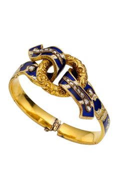 This antique ribbon bracelet dates back to the 1860's and features allover blue and white enamel detail that is entwined around a center gold disc as well as with several rose cut diamonds