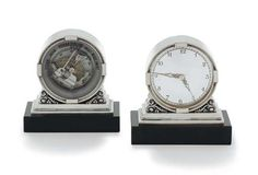 A RARE SILVER CLOCK AND BAROMETER DESIGNED BY JOHAN ROHDE  MARK OF GEORG JENSEN AND WENDEL, COPENHAGEN, 1945-1951  Each on a black stone rectangular base, the silver circular clock with stepped border and squares at intervals, set on a scroll and stepped base. Christie's.
