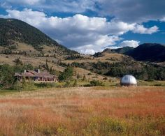 """Dennis Quaid's ranch. Aspen and fir trees surround the wood-and-stone residence of actor Dennis Quaid, on 500 acres once partly owned by actor Warren Oates in Montana's Paradise Valley. At right is the observatory. """"I was into astronomy as a kid,"""" says Quaid. """"Now I sit and watch the stars."""""""