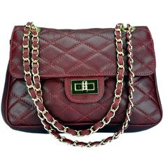 Italian quilted  sauvage leather handbag ,  Shoulder strap of 19-1/2 inches   Leather stringled strap  One internal compartment   One zipped pocket 6 inches long    Metal Accents   Made of genuine leather  Handmade in Italy   Height of bag is 6 inches  Length of bag on bottom is 9-1/2 inches  Width of bag on bottom is 3 inches