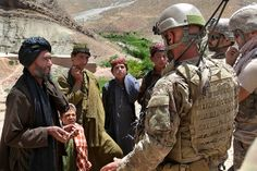 Discussion with village elder  U.S. Army Special Forces Soldiers speak with a village elder during a Convoy Reconnaissance Patrol at Badamak, in the Uruzgan province of Afghanistan, May 23, 2011. The purpose of the patrol is to build relationships and trust with local citizens and assess safety, security, and insurgent threats in the area. U.S. Army photo by Pfc. Simon Lee