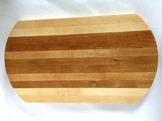Curved Maple and Cherry Cutting Board  by SmithCustomWoodworks