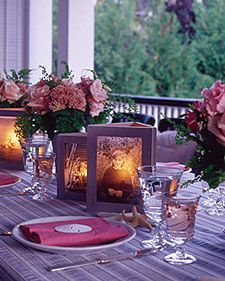 Photo Centerpiece - glue several backless frames together with a flameless candle in the middle!