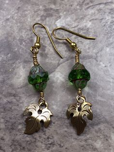 Handcrafted earrings are made a Beautiful green leaf earrings made with 16mm Antiqued Brass Ox Charm Leaf Drop Stamping and Czech Glass Oz Picasso Turbine 11x10mm'.