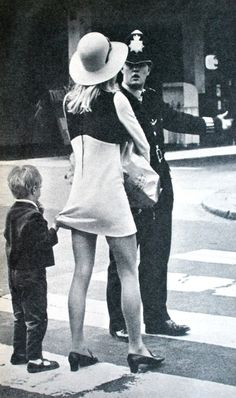 Child holding his mother's mini skirt in the streets of London. Margriet (Dutch) February 1968