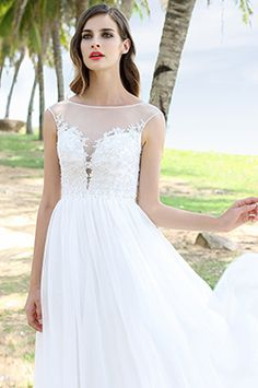 Want a romantic wedding and also worry about the cost? Choose lace simple wedding dress A-line cheap. This sheer top embroidery bodice wedding dress is soft, lithe and fashion. Prepare for your wedding!