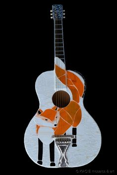 """The Plan: Donate """"Fantastic Mr. Fox"""" guitar to The Michael J. Fox Foundation for Parkinson's Research to auction off and donate proceeds to the organization. (Even better? Get it autographed by Michael J. Fox himself!) April is Parkinson's Awareness Month - donate to this wonderful organization to accelerate a cure.    Hand-cut stained glass on retired acoustic guitar. ©KACIE mosaics & art    www.kacieonline.com"""