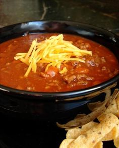 Easy Mild Chili Recipe - brown and drain 1 lb hamburger. Sprinkle 1 (1.25 oz) package McCormick mild chili seasoning over hamburger & stir to coat. Stir in 3/4 cup water and boil for 2 mins. Add 1 (16 oz) can bush chilli beans & 1 (15 oz) can tomato sauce. Simmer til warm then serve w/ shredded cheddar cheese, chopped onions, and/or saltines!