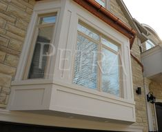 GFRC was used on this bay window. Blends beautifully with the natural stone. Using various materials and textures on the exterior of a house adds character that will be appreciated for decades. Precast Concrete, Cast Stone, Cornice, Bay Window, Columns, Natural Stones, Interior And Exterior, Custom Design, It Cast
