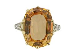 Precious topaz and diamond ring, circa 1905.