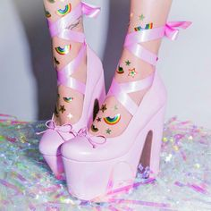 (pink heels with ribbons. they're a little too high, but I'd wear them for a costume if it required them).