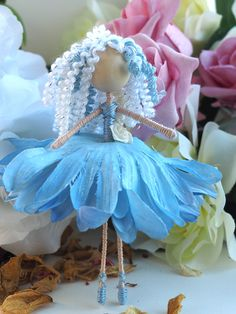 Flower fairy doll dressed in blue and white