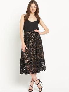 Warehouse Lace Prom Midi Skirt - Black The season's love for lace is showcased beautifully in the premium design of this prom midi skirt by Warehouse. Its nude lining offers virtually undetectable coverage and offsets the sheer overlay. Crafted from intricately detailed lace with scalloped eding, theoverlay is trimmed with ladder detailing for a polished finish.Go for a monochromatic lookwith black heeled sandals and a white Bardot top, or pair with a black top to keep things dark and…